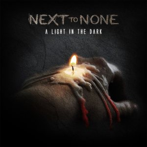 Next to None - A Light in the Dark cover art